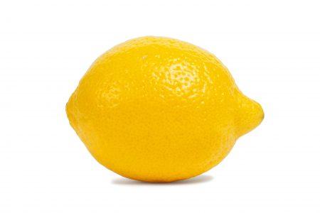 Macro of lemon isolated on white background